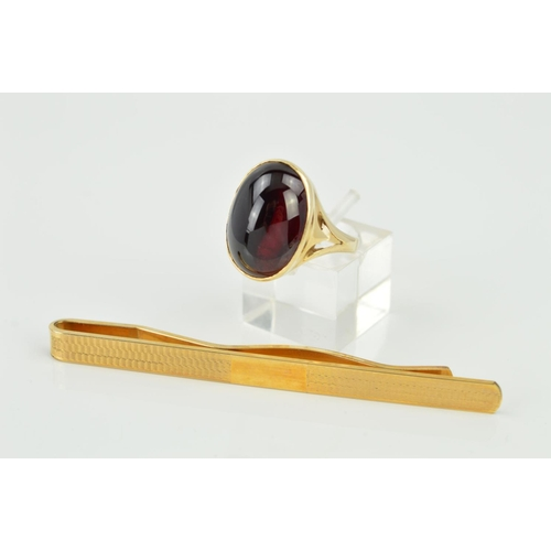 2 - A LATE 20TH CENTURY 9CT GOLD LARGE GARNET RING, an oval cabochon measuring approximately 17mm x 12mm...