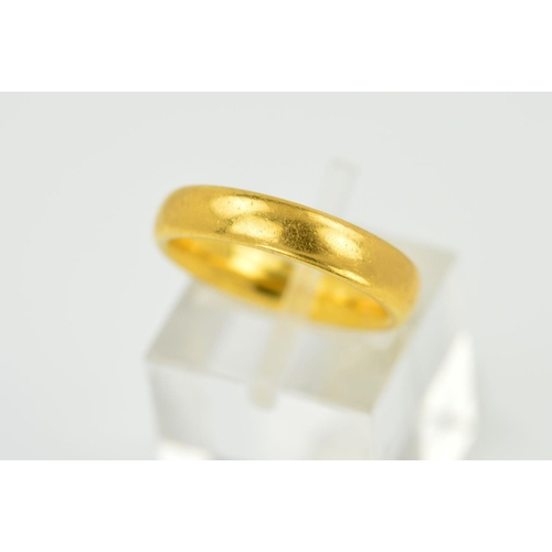 23 - A 22CT GOLD 'D' SHAPED WEDDING BAND, measuring approximately 4.0mm in diameter, ring size K, hallmar...