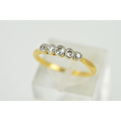 24 - AN EARLY 20TH CENTURY FIVE STONE DIAMOND HALF HOOP RING, estimated old European cut weight 0.20ct, r...