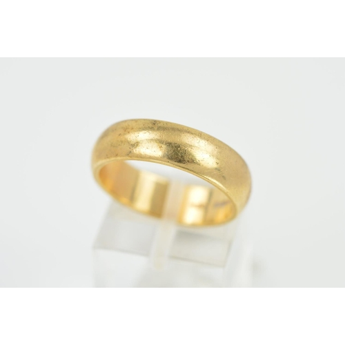 25 - A LATE 20TH CENTURY 9CT GOLD PLAIN WEDDING RING, measuring approximately 11.7mm in width, hallmarked...