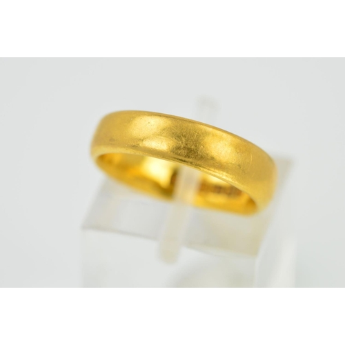 26 - A 22CT GOLD 'D' SHAPED WEDDING BAND, measuring approximately 5mm in diameter, ring size K, hallmarke...