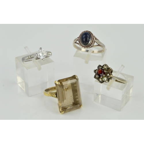 28 - FOUR RINGS, the first designed with circular cubic zirconia and cubic zirconia set shoulders, the se...