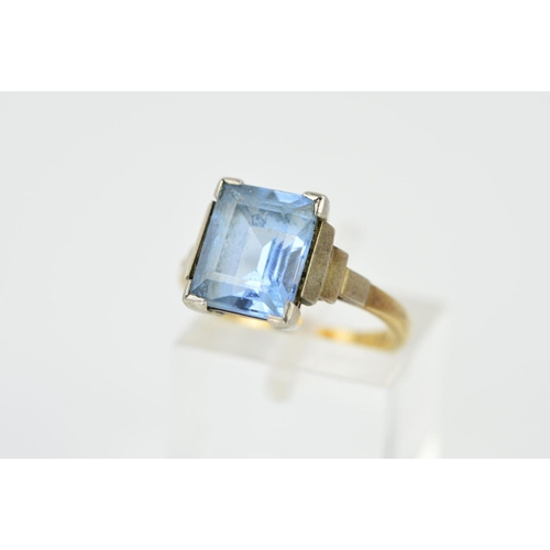 30 - A GEM RING, designed as a central rectangular gem assessed as blue spinel, to the stepped shoulders,...