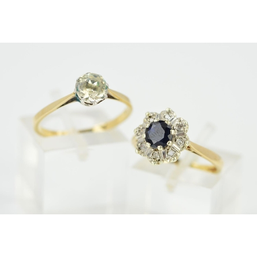 33 - TWO RINGS, the first designed with a single circular colourless paste within an eight claw setting, ...