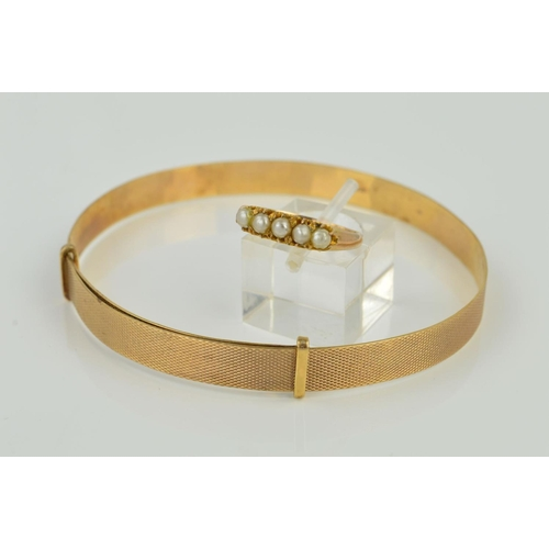 4 - TWO ITEMS OF JEWELLERY to include an expanding bangle measuring approximately 67mm in diameter, engi...