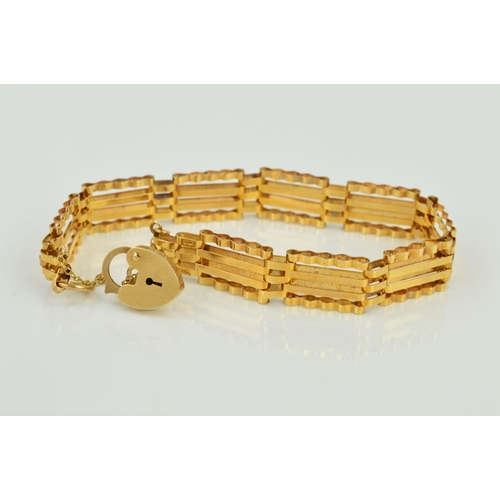 5 - A LATE 20TH CENTURY 9CT GOLD GATE BRACELET, four bar straight design, measuring approximately 180mm ...