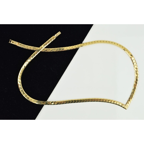 51 - A NECKLACE, designed as a V-shape flattened chain to the hook and push piece clasp, stamped 10Kt, le...