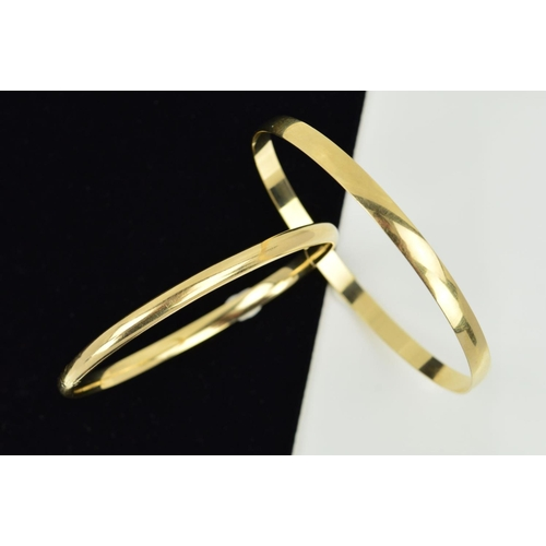 52 - A HINGED BANGLE AND A PLAIN BANGLE, the first of plain hollow design, to the push piece clasp, inner...