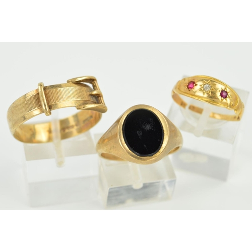 53 - THREE RINGS, the first a signet ring with an oval onyx panel, size S, the second a buckle ring size ...