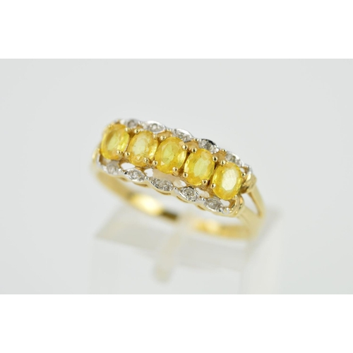 54 - A 9CT GOLD SAPPHIRE AND DIAMOND DRESS RING, designed as a central line of oval yellow sapphires flan...