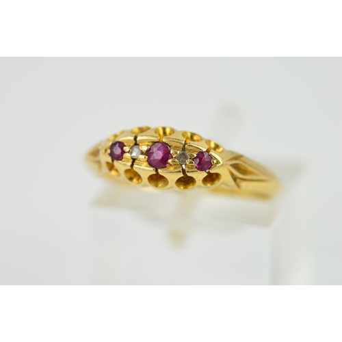 9 - AN EARLY 20TH CENTURY 18CT GOLD RUBY AND DIAMOND FIVE SGTONE RING, ring size M 1/2, hallmarked 18ct ...