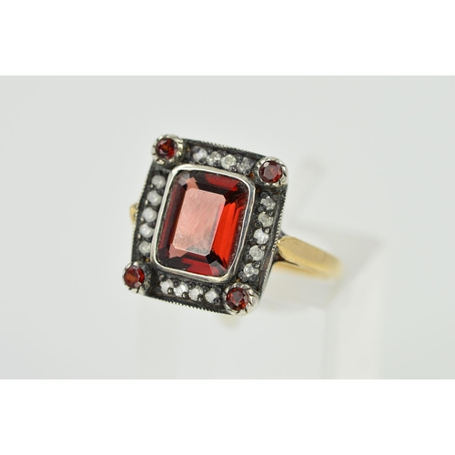 10 - A GARNET AND DIAMOND RING, designed as a rectangular garnet within a brilliant cut diamond surround ...