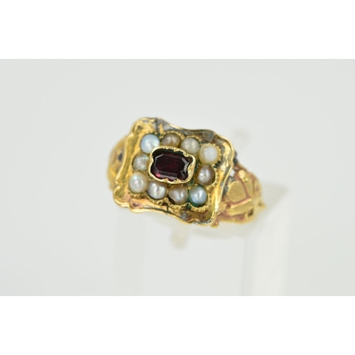 11 - A LATE GEORGIAN GOLD, GARNET AND SPLIT PEARL MEMORIAL RING, the central garnet within a split pearl ...