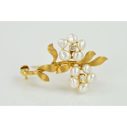 20 - A FRESHWATER CULTURED PEARL AND DIAMOND FLOWER BROOCH, designed as two flowers with freshwater cultu...