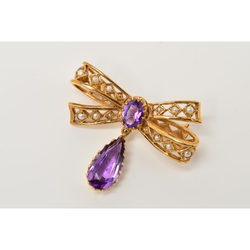25 - A 9CT GOLD AMETHYST AND SEED PEARL FANCY BOW BROOCH, measuring approximately 24.8mm x 19mm, pin and ...