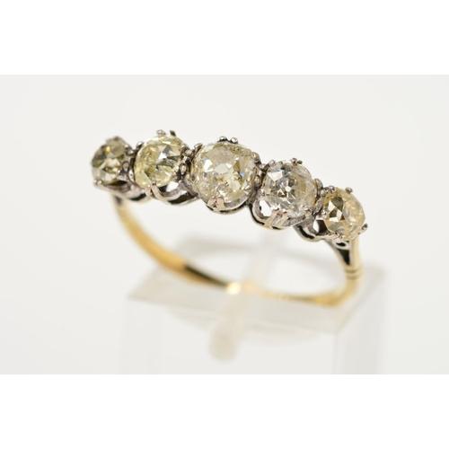 27 - AN EARLY 20TH CENTURY FIVE STONE DIAMOND HALF HOOP RING, Old European cut diamonds graduating in siz...