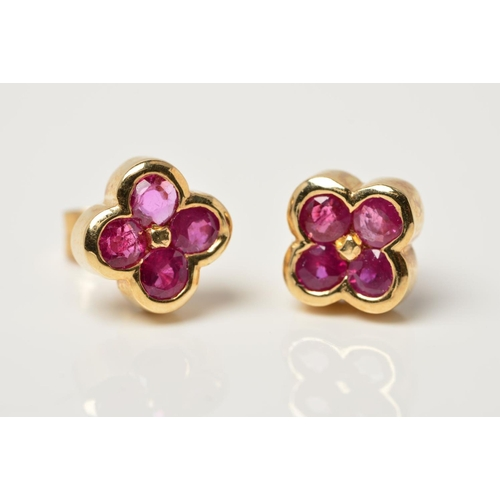 29 - A PAIR OF 9CT GOLD RUBY STUD EARRINGS, each designed as four circular rubies in a quatrefoil shape t...