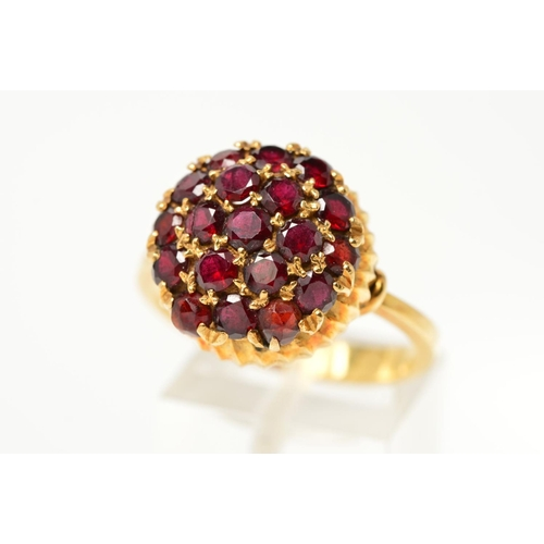 32 - A GARNET AND RED PASTE DRESS RING, designed as circular garnets and red paste in a circular, slightl...