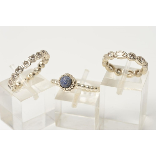 33 - THREE PANDORA RINGS, the first a band ring made of heart shape panels set with colourless cubic zirc...