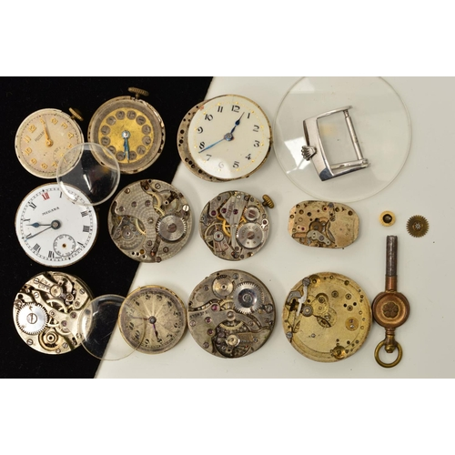 42 - A SMALL SELECTION OF WATCH PARTS, to include a Rolex buckle clasp, two early 20th Century watch move...