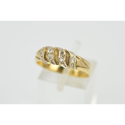5 - A DIAMOND DRESS RING, designed as four tapered, shaped panels each set with single cut diamonds, sta...