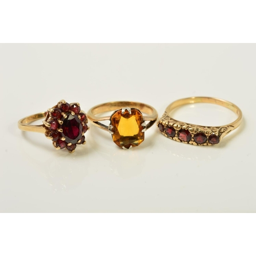 52 - THREE GEM RINGS, the first a graduated five stone garnet ring with scrolling gallery, with 9ct hallm...