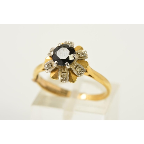 53 - AN 18CT GOLD, SAPPHIRE AND DIAMOND CLUSTER RING, the circular sapphire within a raised claw setting ...