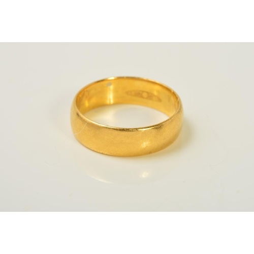 57 - A 22CT GOLD BAND RING, of plain design, with 22ct hallmark for London, width 5mm, ring size M, weigh...