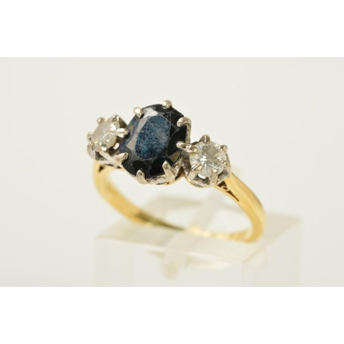 58 - A SAPPHIRE AND DIAMOND RING, designed as a central oval sapphire with a brilliant cut diamond claw s...