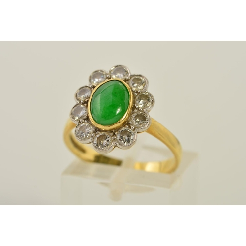 59 - AN 18CT GOLD JADE AND DIAMOND CLUSTER RING, designed as a central oval jade cabochon within a collet...
