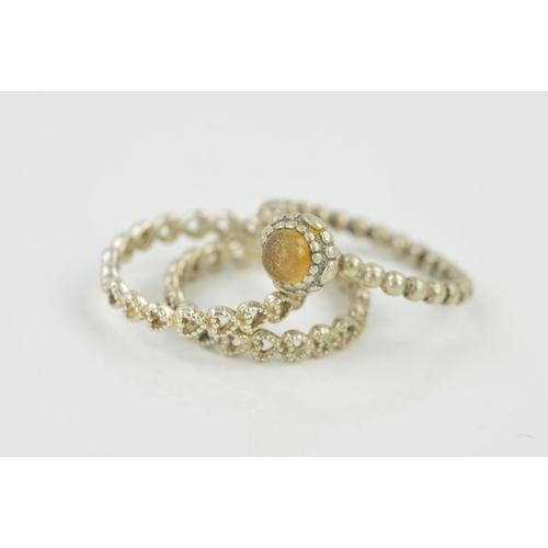 8 - THREE PANDORA RINGS, two designed as a band of beaded, open heart shape panels, the third a beaded b...
