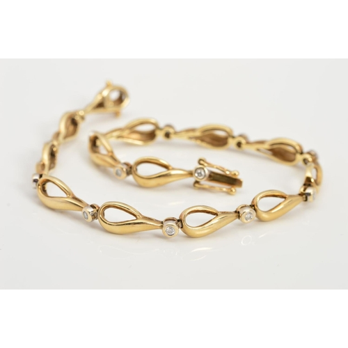 14 - A 9CT GOLD DIAMOND SET BRADELET, each link designed as an open pear shape interspaced by a collet se...