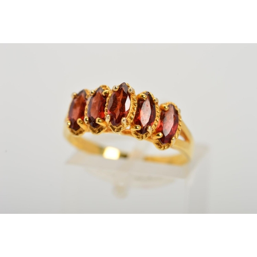 16 - A 9CT GOLD GEM DRESS RING, designed as five marquise shape red gems, assessed as garnets set in a st...