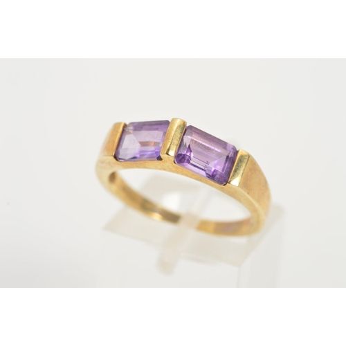 20 - A 9CT GOLD AMETHYST RING, designed as two rectangular amethysts horizontally set at an upward angle,...