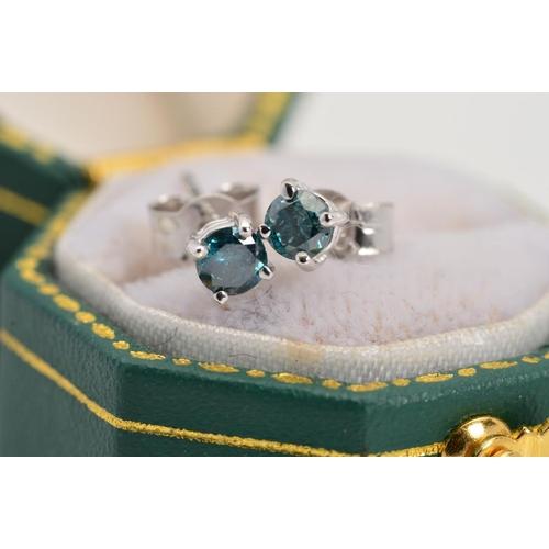 24 - A PAIR OF 18CT WHITE GOLD TREATED BLUE DIAMOND STUD EARRINGS, each designed as a brilliant cut diamo...