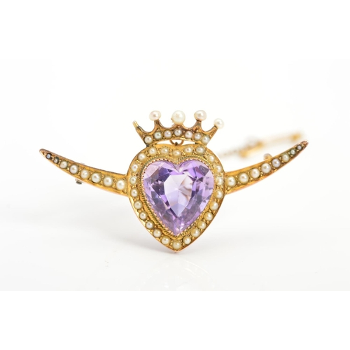 3 - AN EARLY 20TH CENTURY 9CT GOLD AMETHYST AND SEED PEARL HEART BROOCH, the central amethyst heart with...