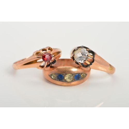 40 - THREE EARLY 20TH CENTURY 9CT GOLD GEM SET RINGS, the first claw set with a circular garnet, the seco...