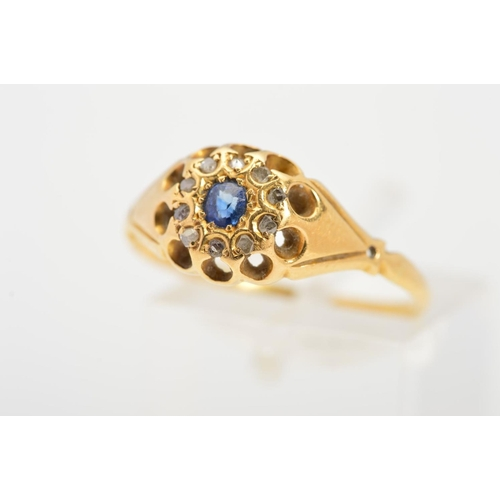 5 - A LATE VICTORIAN 18CT GOLD SAPPHIRE AND DIAMOND RING, the central circular blue sapphire within a si...