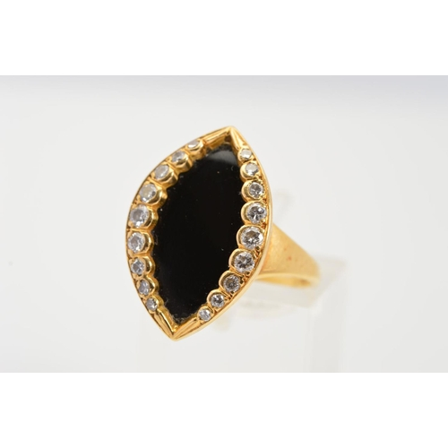 52 - AN 18CT GOLD ONYX AND DIAMOND RING, designed as a marquise shape onyx panel bordered to each side wi...
