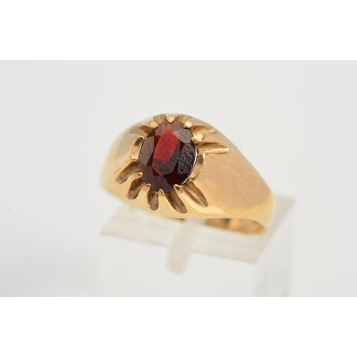 18 - A 9CT GOLD GARNET RING, designed as a claw set oval garnet to the tapered band, with 9ct hallmark fo...