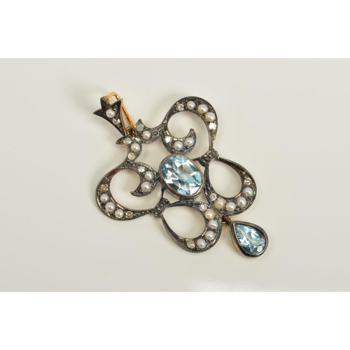 31 - A TOPAZ, SPLIT PEARL AND DIAMOND PENDANT, of openwork scrolling design set with brilliant and single...