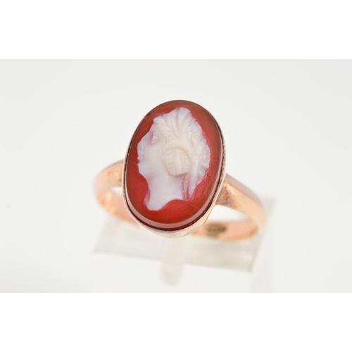 50 - A HARDSTONE CAMEO RING, designed as an oval cameo in a collet setting, stamped 9ct, ring size O, app...