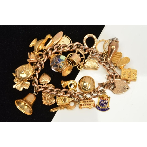52 - A CHARM BRACELET, the curb link bracelet suspending twenty four charms to include a Stanhope hinged ...