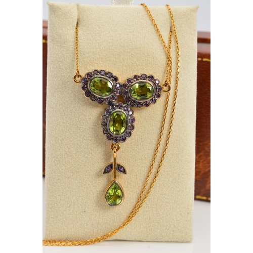 6 - A PERIDOT AND AMETHYST NECKLACE, designed as three clusters of oval peridots within circular amethys...