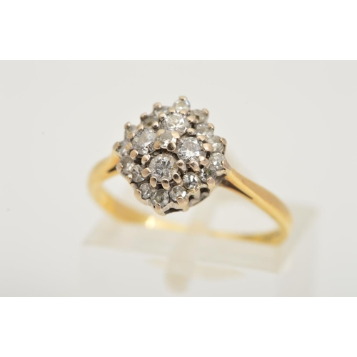 29 - AN 18CT GOLD DIAMOND CLUSTER RING, designed as a three tier cluster of single and brilliant cut diam...