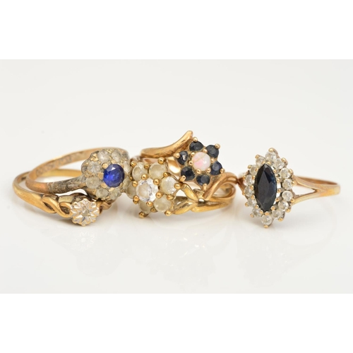 4 - FIVE GEM SET RINGS, to include a single cut diamond in a star illusion setting, an opal and sapphire...