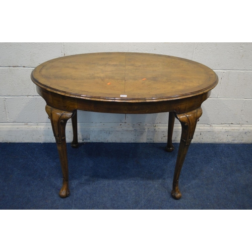 1213 - A REPRODUCTION GEORGE II STYLE WALNUT AND CROSSBANDED OVAL CENTRE TABLE, on four cabriole legs termi...