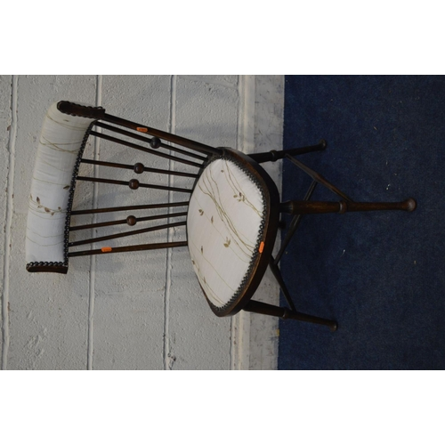 1226 - IN THE MANNER OF JOSEF HOFFMANN, an early 20th Century mahogany spindle back chair on padded front f...