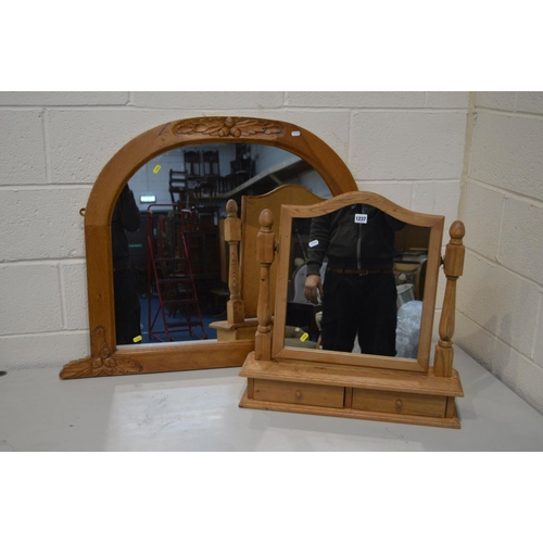 1237 - A MODERN PINE WALL MIRROR with foliate detail to top and bottom corners together with a pine swing m...