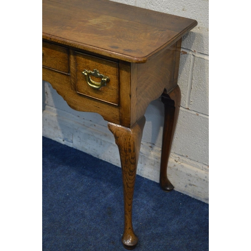 1272 - A TWENTIETH CENTURY OAK GEORGIAN STYLE LOW BOY, of narrow proportions, two deep drawer flanking a ce...